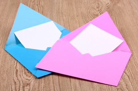 Color envelopes on wooden background Stock Photo - 12217697