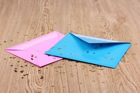 Color envelopes and confetti on wooden background Stock Photo - 12217702