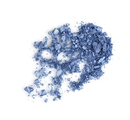 Crushed eyeshadows isolated on white photo