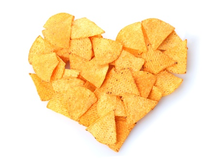 Delicious potato chips heart shape isolated on white photo