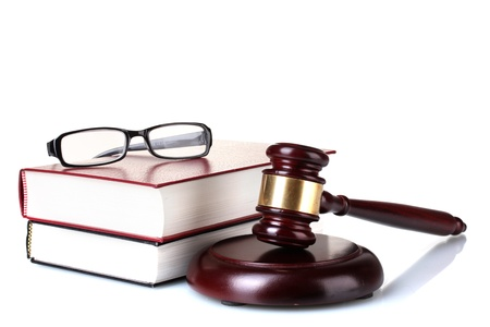 wooden gavel, glasses and books isolated on white Stock Photo - 12217479