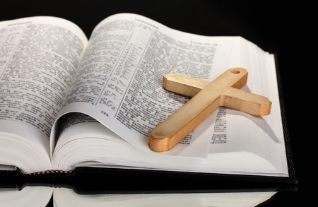russian church: Russian bible and wooden cross on black background Stock Photo