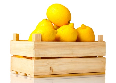 ripe lemon in wooden box isolated on white photo