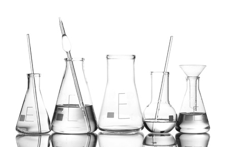 Different laboratory glassware with water and empty with reflection isolated on white Stock Photo - 12311138