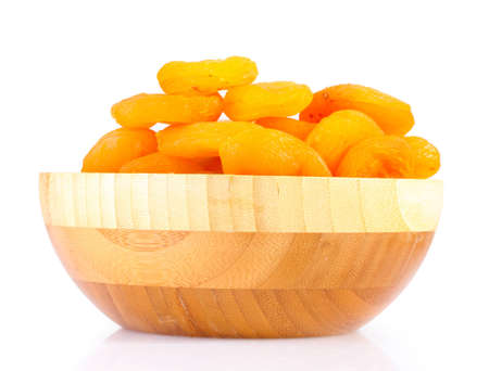 delicious dried apricots in wooden bowl isolated on white Stock Photo - 12310904