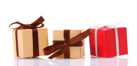 beautiful gifts with bows isolated on white photo