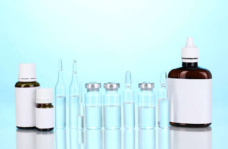 airtight: Medical bottles and ampoules on blue background