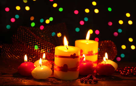 Beautiful candles on wooden table on bright background Stock Photo - 12310796