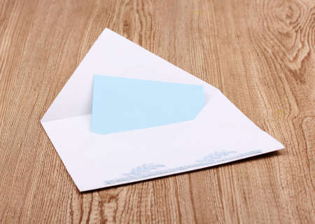 White envelope on wooden background Stock Photo - 12310687