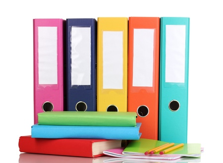 Bright office folders and books with stationery isolated on white photo