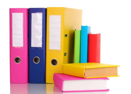 Bright office folders and books isolated on white photo