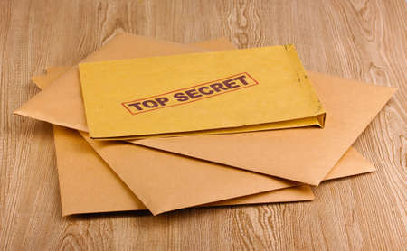 Envelopes with top secret stamp on wooden background Stock Photo - 12310658