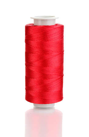 Red bobbin thread isolated on white photo