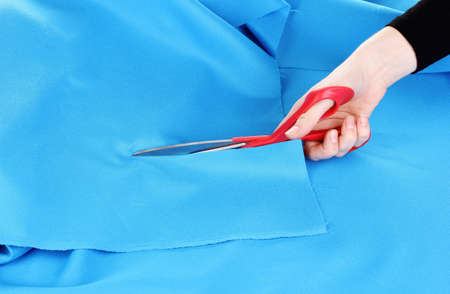 Woman cutting fabric photo