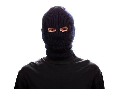 Bandit in black mask isolated on white Stock Photo
