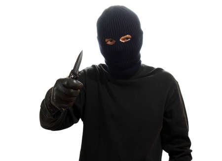 Bandit in black mask with knife isolated on white Stock Photo - 12311199