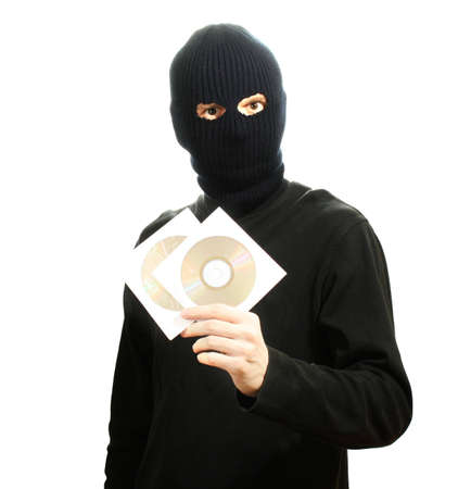 Bandit in black mask with CD disks isolated on white Stock Photo - 12310426