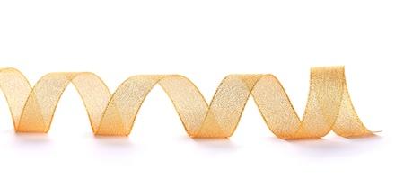 golden ribbon: beautiful golden ribbon isolated on white Stock Photo