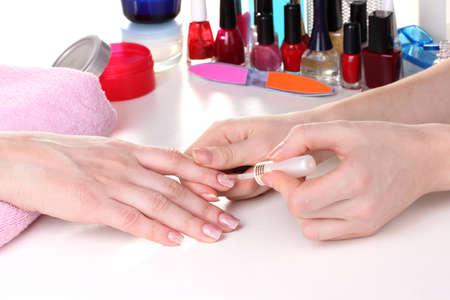 acrylic nails: Manicure process in beautiful salon