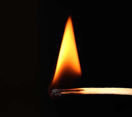 Burning match on black background Stock Photo - 12311181