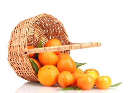 tangerines with leaves in a beautiful basket isolated on white Stock Photo - 12310533