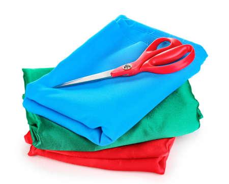 Scissors on fabric isolated on whiteblue red photo
