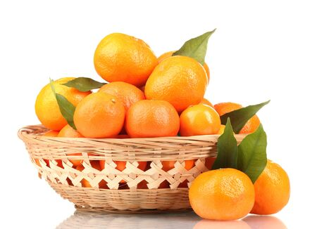 tangerines with leaves in a beautiful basket isolated on white Stock Photo - 12438765