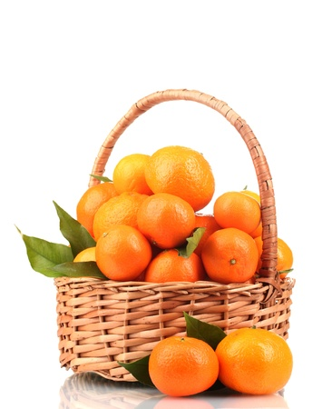 tangerines with leaves in a beautiful basket isolated on white Stock Photo - 12438734