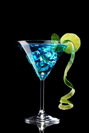 blue hawaiian drink: Blue cocktail in glass on black background