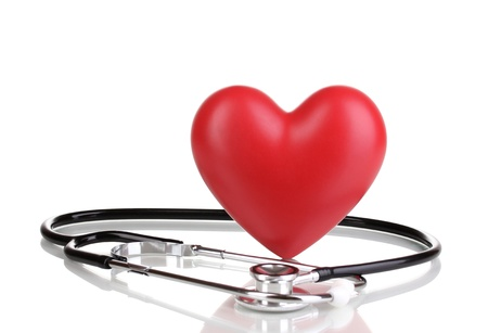 stetoscope: Medical stethoscope and heart isolated on white