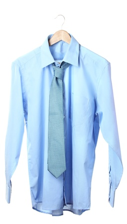 Blue shirt and tie on wooden hanger isolated on white photo