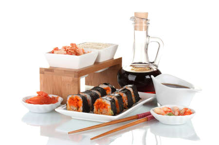delicious sushi on plate, chopsticks, soy sauce, fish and shrimps isolated on white Stock Photo - 12439626