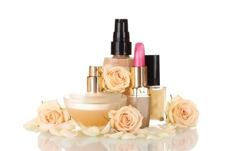Сosmetics with roses isolated on white photo