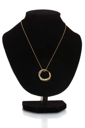 Pendant in form of rings with gem on mannequin isolated on white photo