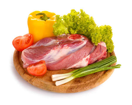 Raw meat and vegetables on a wooden board isolated on whitе Stock Photo - 12439943