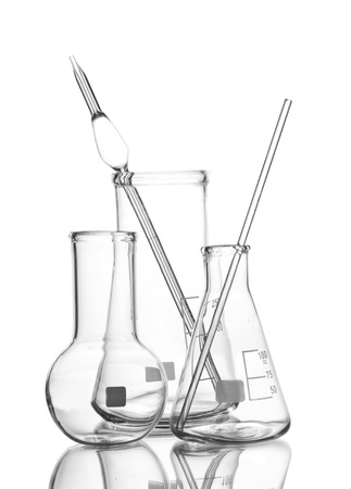 Three empty laboratory glassware with reflection isolated on white photo