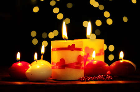 Beautiful candles on wooden table on bright background Stock Photo - 12439638