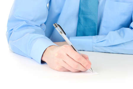 Businessman writing on document photo