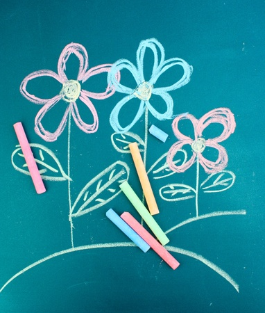 Flowers, childs drawing with chalk photo