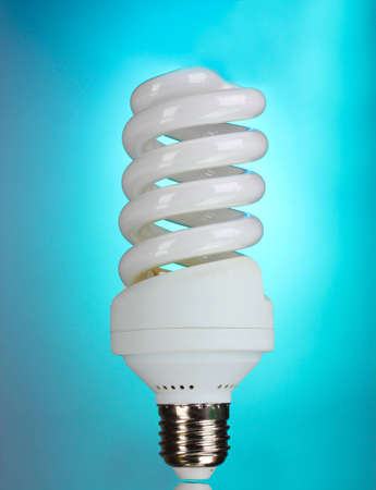 energy saving light bulb on blue background  photo