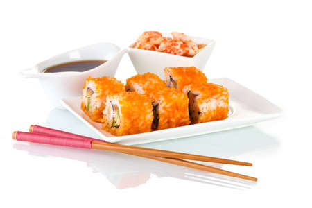 delicious sushi on plate, chopsticks, soy sauce and shrimps  isolated on white Stock Photo - 12439192