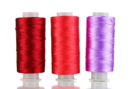Three bobbin thread isolated on white photo