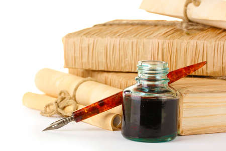 old books, ink pen and ink bottle isolated on white Stock Photo - 12439074