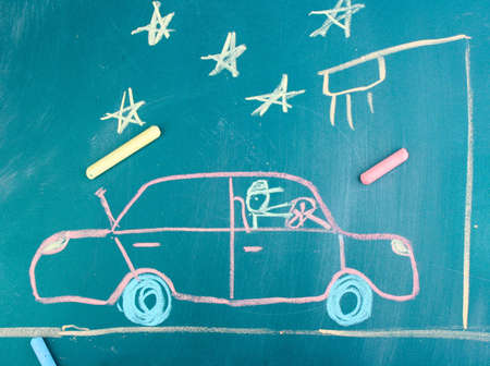 Car on road, childs drawing with chalk photo