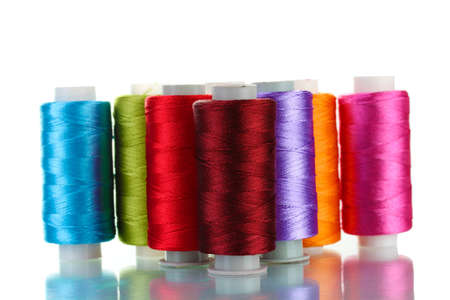 bright bobbin thread isolated on white  Stock Photo - 12439024