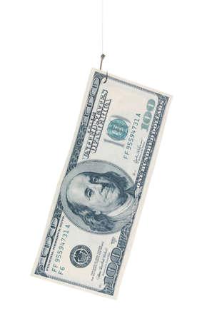 Money on fish hook isolated on white photo