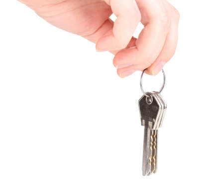 Keys in hand isolated on white Stock Photo - 12439313