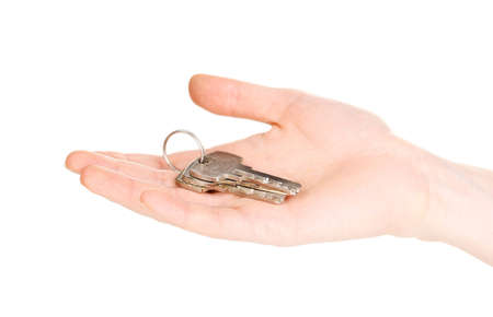 Keys in hand isolated on white Stock Photo - 12434353