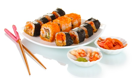 delicious sushi on plate, chopsticks, sauce, fish and shrimps isolated on white photo