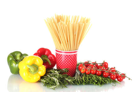 spaghetti in red cup, paprika, tomatoes cherry and rosemary isolated on white photo